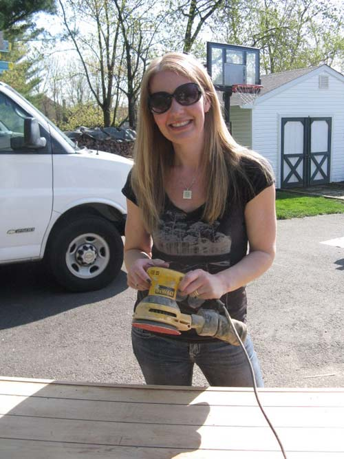 Homeowner Jen ready to try her luck at sanding.