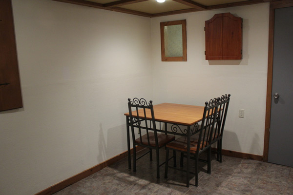 Chris and Danielle's large basement actually had two separate spaces, including this corner area where they had their old dining room table.