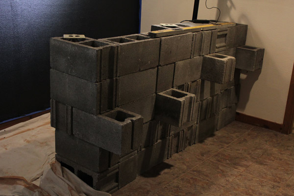 Begin by laying the first row of cinder blocks,...