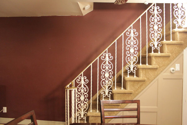 Mike hated this dated wrought-iron stair railing.