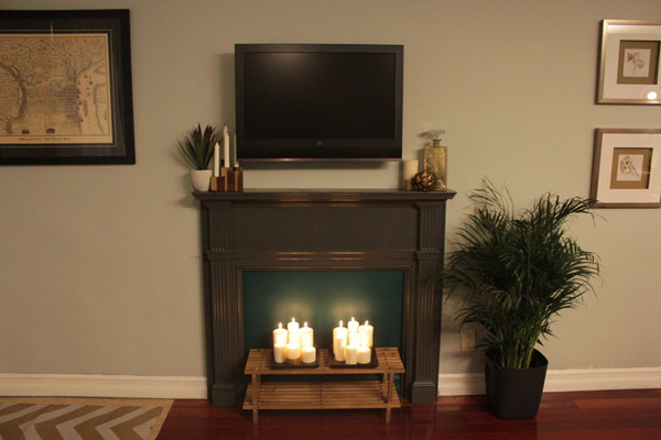 If you want to add instant character, charm and warmth to your space, this is the project for you! This DIY fake fireplace is a great way to fill a blank wall and take the focus off of a big TV.