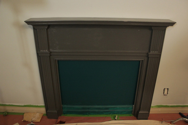 Attach the fireplace to the wall with a nail gun...