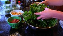 Audrey Barbera prepares a fresh spinach salad, topped with bacon, avocado and pears.