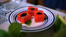 These bite-sized cubes of watermelon are filled with a little bit of balsamic vinegar glaze and served with mint or basil for a sweet and savory summertime treat.