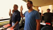 Joey taking his oath before graduating from the Kansas City BBQ Societys judging school.