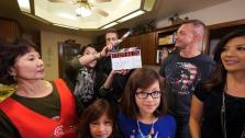Joey Fatone and the whole family in the kitchen getting ready to start shooting the episode.